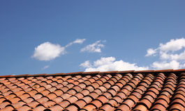 Shingled Roof with Blue Sky Background Stock Photo