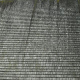 Shingled roof. Moss growing on a wooden shingled rooftop Stock Photo
