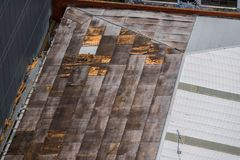 Destroyed and damaged roof stock photography