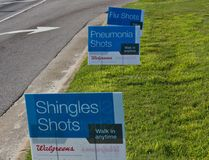 Shingles, Pneumonia, and Flu Shot Signs Stock Photography