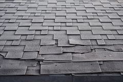 Shingles roof damage covered with frost. Close up view on Asphalt Roofing Shingles Background. Roof Shingles - Roofing royalty free stock photo