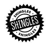Shingles rubber stamp. Grunge design with dust scratches. Effects can be easily removed for a clean, crisp look. Color is easily changed Royalty Free Stock Images