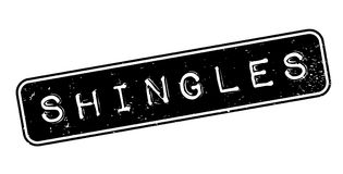 Shingles rubber stamp. Grunge design with dust scratches. Effects can be easily removed for a clean, crisp look. Color is easily changed Stock Photos