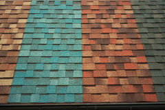 Shingles samples on roof. Different colors of shingles samples on roof Royalty Free Stock Photography