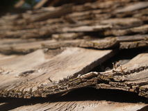 Shingles. Wooden shingles, warping in the sun, top a roof in the desert of Utah stock photo