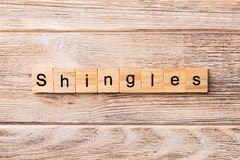 Shingles word written on wood block. Shingles text on wooden table for your desing, concept royalty free stock image