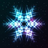 Shining abstract star snowflake. Bright, shining and glaring abstract snowflake. Beautiful decorative cosmic star on dark background. Vector EPS10 file Stock Photography