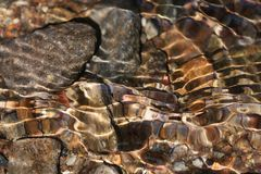 Shining abstract stone formations in a mountain creek Royalty Free Stock Image