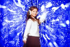 Shining background for christmas. A portrait of a cute girl over a shining background. Christmas, New Year party royalty free stock photography