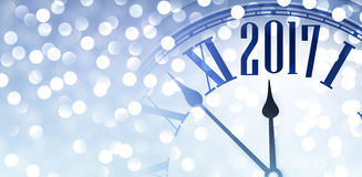 2017 shining banner with clock. 2017 year blue banner with clock and lights. Vector illustration Stock Images