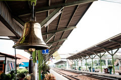 Shining bell in train station Stock Photos