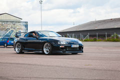 Shining black Toyota Supra A80 goes on street Royalty Free Stock Photo