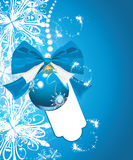 Shining blue Christmas ball on the background with Royalty Free Stock Image
