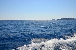 Shining blue Mediterranean sea. View from the yacht. Foamy waves stock photography