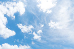 Shining on blue sky with clouds and light of the sun stock photography