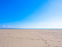 Shining blue sky, sea and sand beach Stock Photos