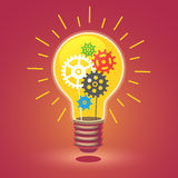 Shining bright idea light bulb with cogs Royalty Free Stock Photos