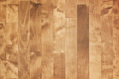 Shining brown wooden parquet. Background texture Royalty Free Stock Image