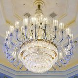 Shining chandelier hanging on a ceiling in hotel Stock Image