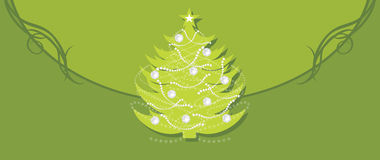 Shining Christmas fir tree on the green background Royalty Free Stock Photography