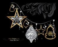 Shining Christmas garland on black background. Greeting card stock photography