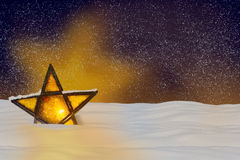 Shining Christmas star at night Stock Images