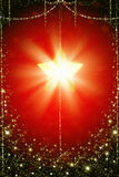 Shining Christmas Star. On red background Royalty Free Stock Photo