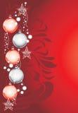 Shining Christmas toys on dark red decorative background royalty free stock photo