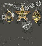 Shining Christmas toys and tinsel on a dark gray background royalty free stock photography