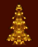 Shining Christmas tree. Christmas decoration tree with numerous lights over dark background stock images