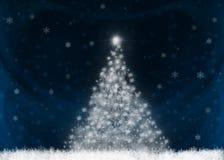 Shining Christmas tree. On blue background Stock Photo