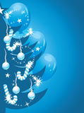 Shining Christmas tree on the dark blue background Royalty Free Stock Image