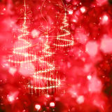 Shining Christmas tree with golden sparkles Royalty Free Stock Photography