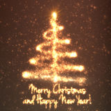 Shining christmas tree on orange background with backlight and glowing particles. Abstract vector background. Glowing fir-tree. Elegant shining background for Stock Photography