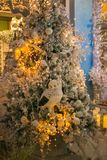 Shining Christmas tree with owl and decorations Stock Images
