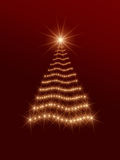 Shining christmas tree in red. Shining christmas tree drawn by golden lights over red background Stock Photo