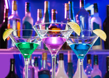 Shining cocktail glasses in the bar with limes Stock Image