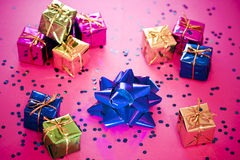 Shining colorful Christmas presents. Christmas gift decoration creating a heart shape stock photography