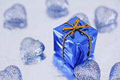 Shining colorful Christmas presents. Blue Christmas gift and heart decorations stock photography