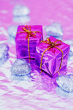 Shining colorful Christmas presents. Blue and purple Christmas gift and heart decorations royalty free stock photo
