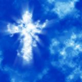 Shining cross in cloudy sky. Holy shining cross in the blue cloudy sky Royalty Free Stock Images