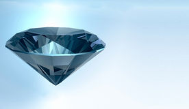 Shining crystal diamond on a blue background Stock Image