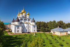 Shining cupola of orthodox monastery in summer day with car and graveyard Stock Images