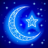 Shining decorative half moon with star on blue night starry sky. Background. Islamic design Ramadan Kareem greeting card and placard. There is in addition a Stock Images