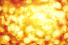 Shining defocused highlights in gold and yellow Stock Images