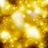 Shining festive golden background. With stars Royalty Free Stock Image