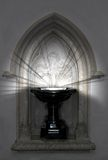 Shining font. Baptismal font with mysterious lights shining royalty free stock images