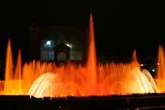 Shining fountain in the night. Fountain light show in Prag Stock Photos