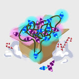 Shining garland in cardboard box and candies Royalty Free Stock Photography