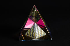 Shining glass pyramid in black background Royalty Free Stock Photo